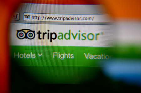 LISBON, PORTUGAL - AUGUST 3, 2014: Photo of TripAdvisor homepage through a magnifying glass. Фото со стока - 34848492