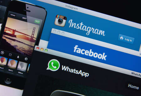 LISBON, PORTUGAL - MARCH 13, 2014: Photo of Facebook, Instagram and Whatsapp homepage on a monitor screen