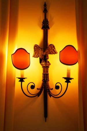 Elegant wall lamp on wooden wall photo