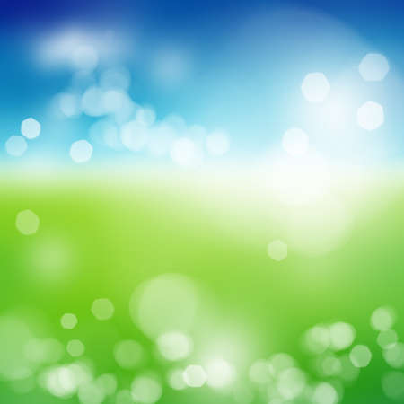Blurry green field and blue sky with summer sun burst