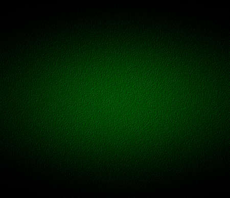 Green background or green paper with bright spotlight on black background texture photo
