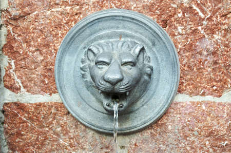 Drinking fountain, lion  photo