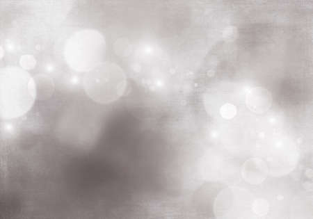 Gray abstract background with a white light blur