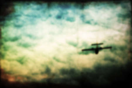 sunset sky: Blurred airplane silhouette in blurred sunset sky. Stock Photo