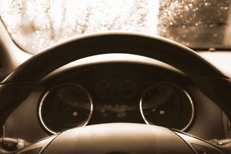 Close up shot of a speedometer in a car. Car dashboard. Dashboard details with indication lamps.Car instrument panel. Dashboard with speedometer, tachometer, odometer. Car detailing. Black and white Stockfoto