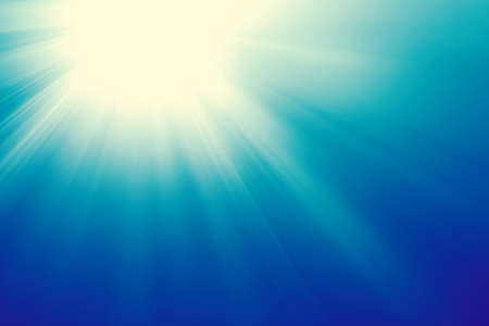 Sun on a blue sky with rays and flare, abstract fresh sunburst background. Фото со стока