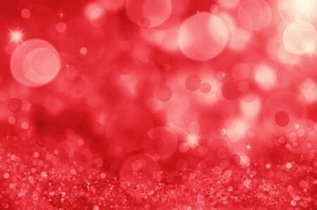 Abstract red holiday background, beautiful shiny Christmas lights, glowing magic bokeh