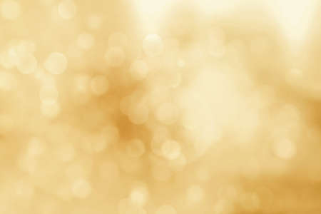 Golden abstract christmas lights. Christmas soft gold Bokeh background
