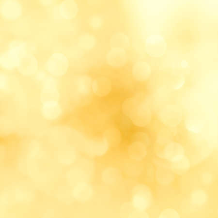 Golden sparkle glitters with bokeh effect and selectieve focus. Festive background with bright gold lights, orange bubble. Luxury Christmas mood concept. Copy space, close up, texture, top view.