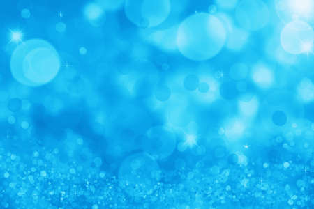 Abstract blue holiday background, beautiful shiny Christmas lights, glowing magic bokeh