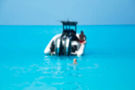 Blurred image of tourists and motorboat in tropical sea. speedboat and swimming Stockfoto