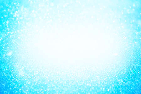 Abstract bokeh background. Glittering background. Abstract blue color background. Glittering background. Blue background Glitter background