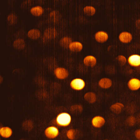 Gold Festive Christmas luxury background. Elegant abstract gold background with golden bokeh defocused lights and stars