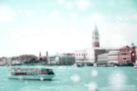 Blurred View of Grand Canal with vaporetto (water bus) stop in front of Piazza San Marco in Venice, Italy with bokeh. Vintage and retro effect.