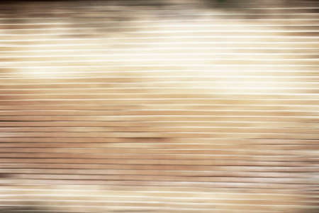 Abstract brown wooden background with motion blurred effect for insert texts. old golden effect luxury speed color 免版税图像
