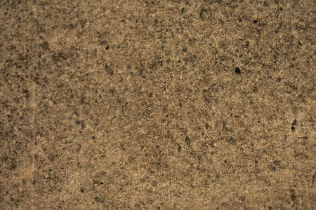 Brown wallpaper with golden rough texture