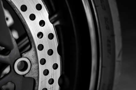 Perforated disc brake on sport motorcycle front wheel