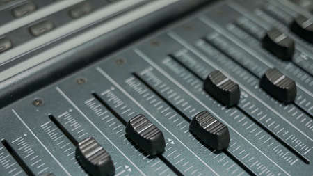 Detail of the faders of a sound mixer from a professional recording studio Stok Fotoğraf
