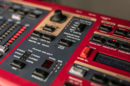Red, classic stage synthesizer, famous for its sounds and style, with a large keypad for control and choice of the sound to be launched live.