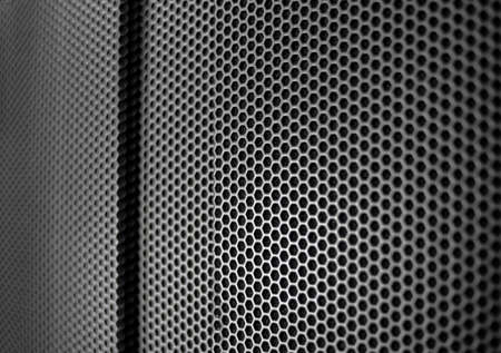 Protective grid close-up of an amplifier as a wallpaper
