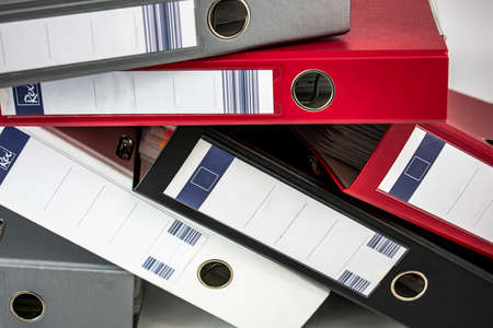 Office document filing cabinets of different colors on white background