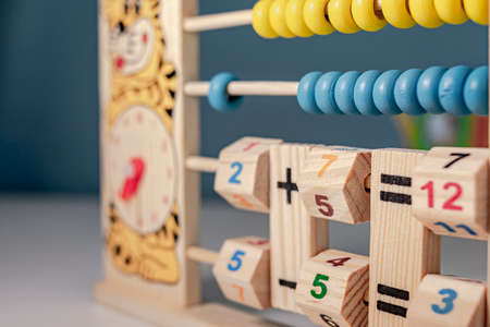 Childrens wooden game to learn the hours of a clock and simple math of addition, subtraction, multiplication and division, called abacus Stok Fotoğraf