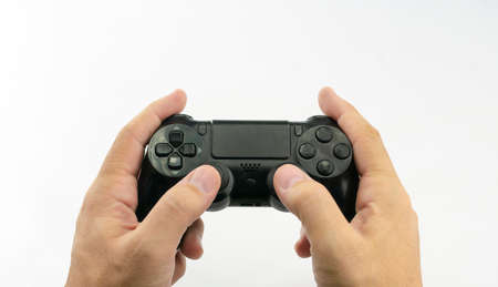 Video game console in black, with joysticks and buttons in the hands of a caucasian man on white background Stok Fotoğraf