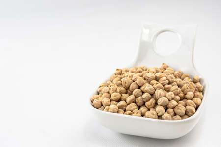Front view of a plate of raw and clean chickpeas ready to cook them in a kitchen recipe. Food or ingredients Stok Fotoğraf