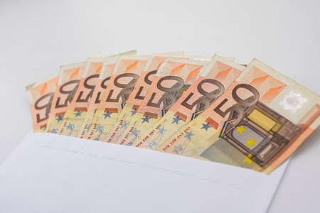 50 euro bills in an envelope