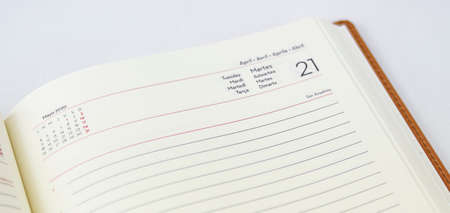 Work agenda with writing lines and day of the week lined in brown leather and on white background