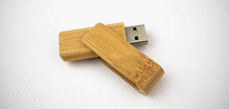 USB device for data storage made of wood, open, on white background
