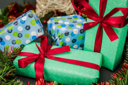 Christmas gifts packed with wrapping paper and a red bow
