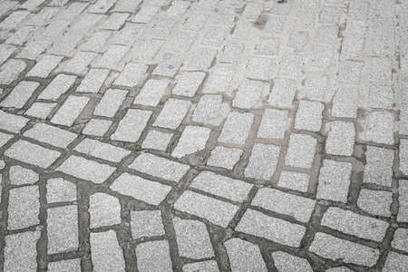 Stone pavers placed in different arrangement in a street of a Spanish city