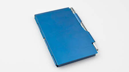 Notepad with a docked and bright pen