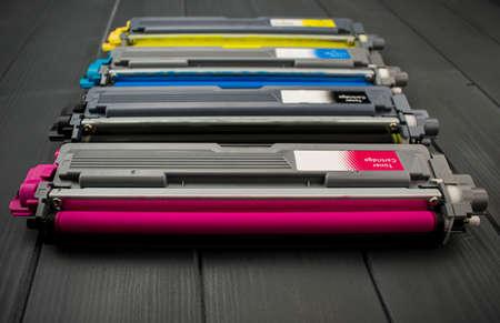 Cyan, magenta, amariyllo and black color toner rollers of a foreground color laser printer