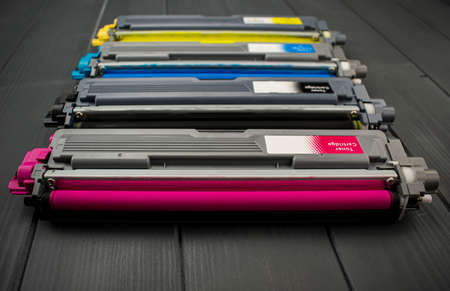 Cyan, magenta, amariyllo and black color toner rollers of a foreground color laser printer