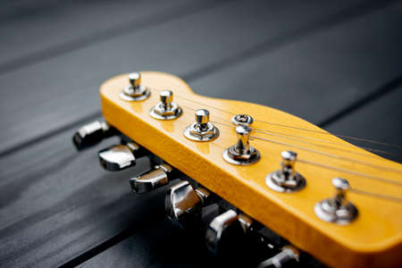 tuning headstock of an electric guitar with shiny chrome elements