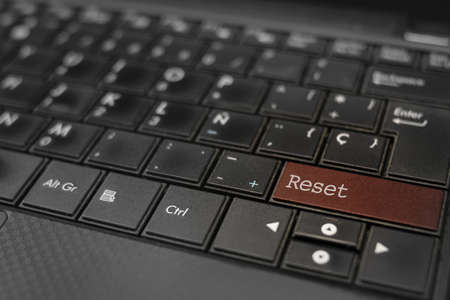 Reset concept. Reset key embedded in a computer keyboard Stock Photo