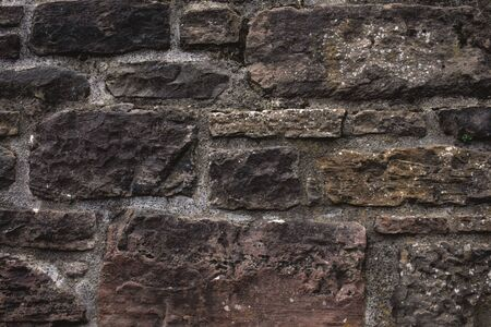 Old castle stone wall texture. Stone wall as a texture or background. Stock Photo