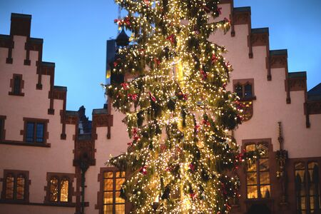 Christmas tree on Christmas eve in Germany, traditional German houses on the background.