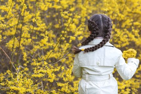 Happiness, joy, spring, hope and long braids. Stock Photo