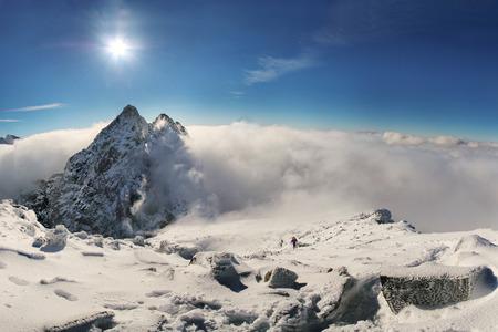 alpinist: Alpinist climbing on Rysy mountain peak in High Tatras. Slovakia. Poland. High Tatras