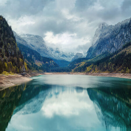 Alpine lake with dramatic sky and mountains. heritage site. Gosausee, Tirol, Austria