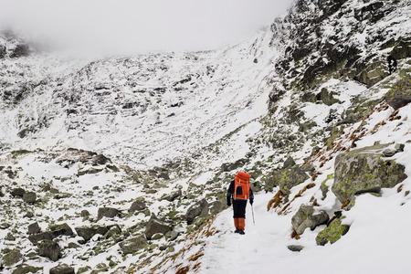 alpinist: Alpinist climbing on mountain route up to peak in High Tatras. Slovakia. Poland. High Tatras