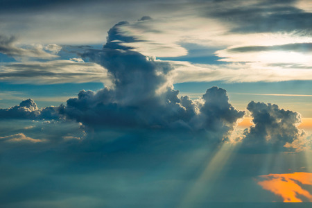 View from airplane on gold clouds photo