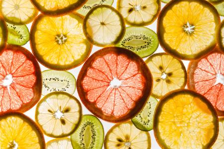 Transparency sliced fruits on white background. Rings of grapefruit, kiwi, lemon and orange Imagens