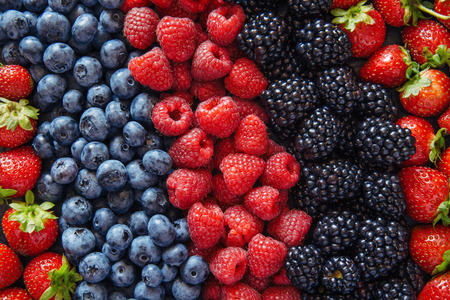 Healthy mixed berries fruit  Imagens