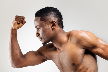 persistent: Running african american man over the light background with persistent look