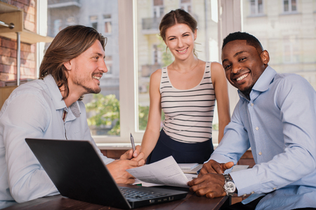 small business team: Business partner having meeting in office and discussing something