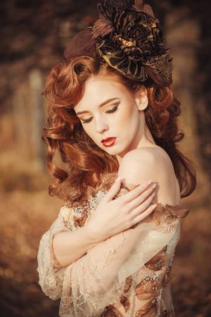 yellow dress: Portrait of beautiful sad woman in autumn season. Soft sunny colors Stock Photo